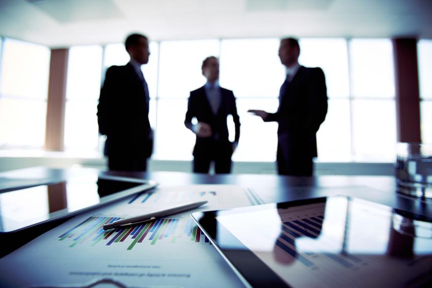 Generic and slightly blurred photo of three businessmen