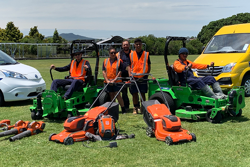 Grounds maintenance staff with electric equipment
