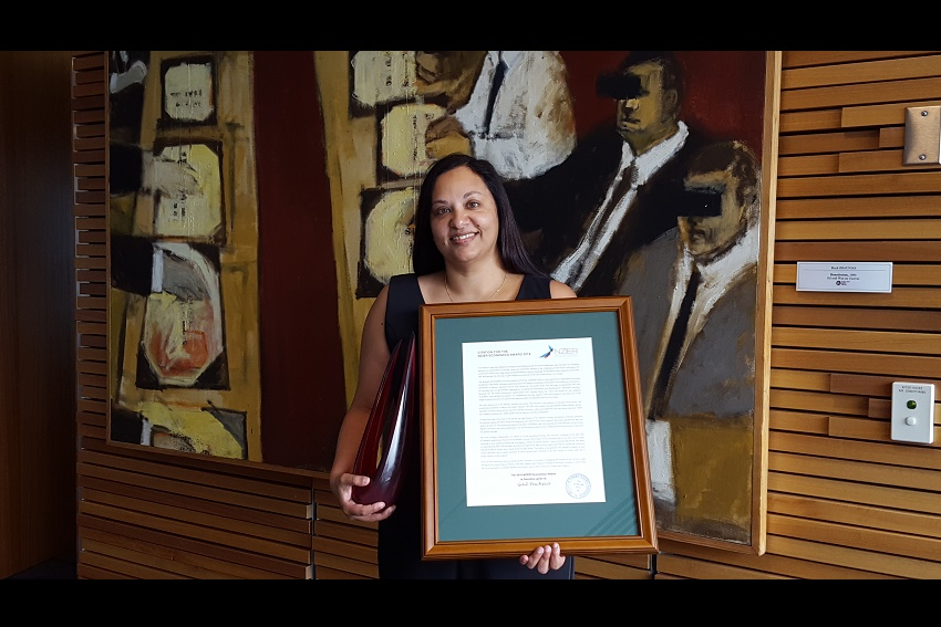 Professor Gail Pacheco with award