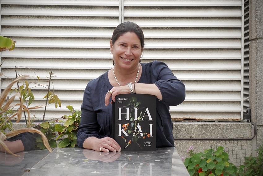 Associate Professor Tracy Berno with the book Hiakai.
