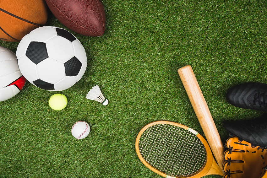 Balls and rackets on AstroTurf