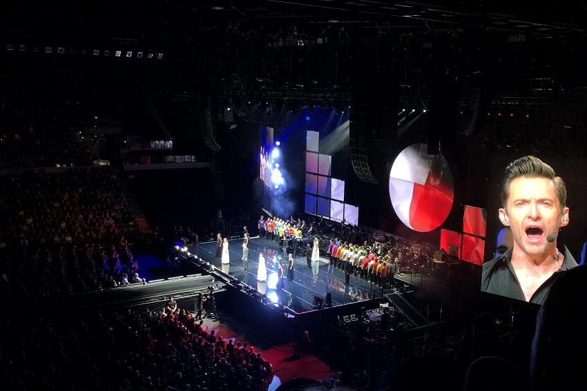 Hugh Jackman performing with choir