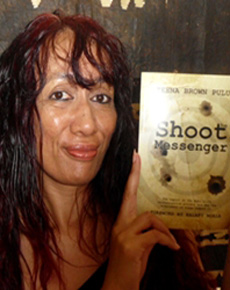 Dr Teena Brown Pulu with her first book, Shoot the Messenger